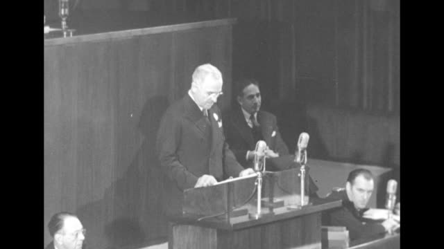 two shots of pres. harry truman standing at podium speaking to general assembly in administration building of world's fair in flushing meadows - united nations general assembly stock videos & royalty-free footage