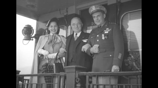 two shots of pres harry truman standing on platform on back of train with general matthew ridgway supreme allied commander europe and ridgway's wife... - matthew b. ridgway stock-videos und b-roll-filmmaterial