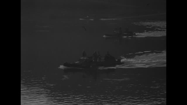 two shots of searchlights at night / us soldiers looking across rhine river at night / searchlight shining on water / vs amphibious vehicles crossing... - amphibious vehicle stock videos & royalty-free footage