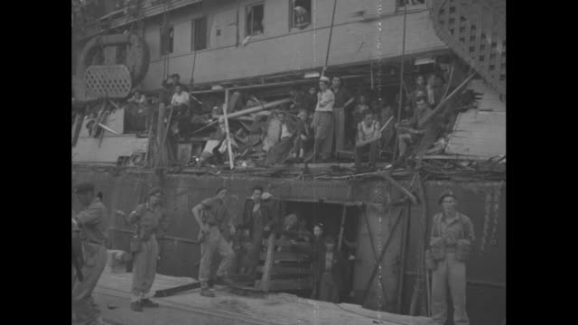 two shots of ship carrying jewish immigrants pulling into dock / words on banner on side of ship saying haganah ship exodus 1947 / star of david flag... - judaism stock-videos und b-roll-filmmaterial