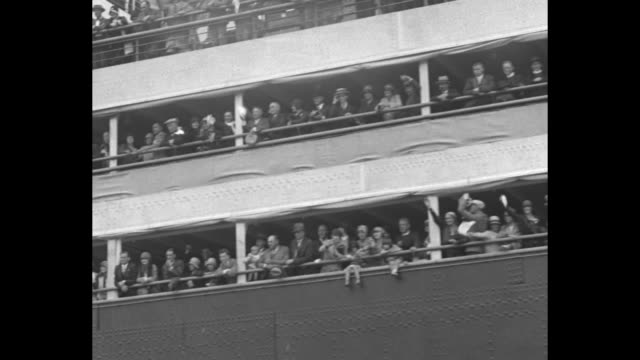 two shots of ss bremen sailing into harbor / line of men crossing gangplank to board ship / panning shot from below of passengers on ship / shot from... - passenger stock videos & royalty-free footage