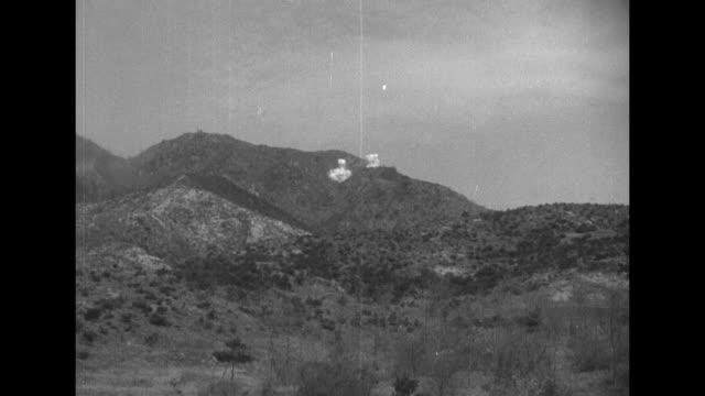 two shots of tank firing / soldier manning machine gun on turret of tank / soldier firing machine gun on turret / soldier firing machine gun on... - kriegsgefangener stock-videos und b-roll-filmmaterial