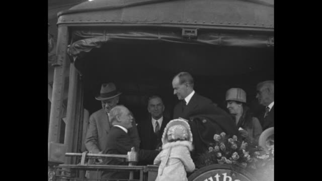two shots of train carrying former president calvin coolidge rolling past camera towards station / coolidge and wife grace on rear platform of train... - coolidge calvin stock videos & royalty-free footage
