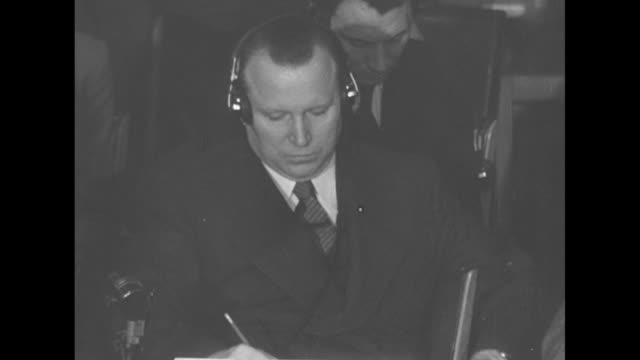 two shots of un delegates listening to west german envoy speaking / close view of west german envoy listening to fellow envoy speaking / close view... - 1951 stock-videos und b-roll-filmmaterial