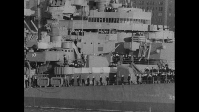 Two shots of US Navy airship / view of boats at anchor in Hudson River / VS USS Missouri with sailors and many people on board / two shots of US Navy...