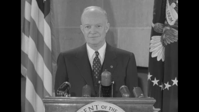 two shots of us president dwight eisenhower standing at podium with microphones on it and speaking to camera sot he discusses godgiven rights and... - human rights stock videos and b-roll footage