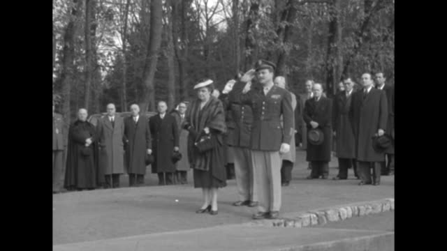 two shots of us soldiers standing in formation presenting arms / luxembourg minister of foreign affairs joseph bech standing in front of dedication... - 1951 stock-videos und b-roll-filmmaterial