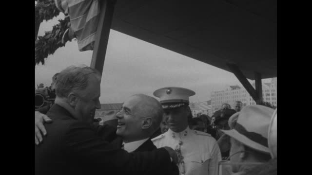 vídeos de stock, filmes e b-roll de two shots of us warship indianapolis carrying us president franklin roosevelt sailing into harbor of montevideo / photographers on ladder on pier /... - montevidéu