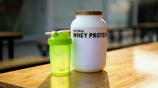 two shots of whey protein and powder shaker bottle blender - protein drink stock videos & royalty-free footage