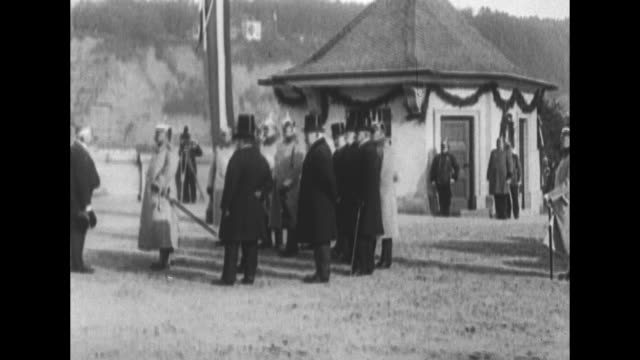 two shots of wilhelm ii in military uniform standing with officials next to pavilion in countryside / large crowd gathered in square / group of women... - esilio video stock e b–roll