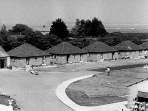 Two shots panning across the chalets at the Coronation holiday camp at Hayling Island 1948