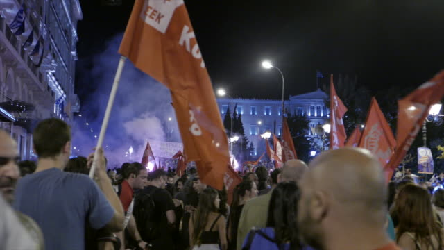two shots sequence filmed moments after referendum results over bailout terms were announced view of greek parliament crowds of people waving red... - ユーロ圏債務危機点の映像素材/bロール