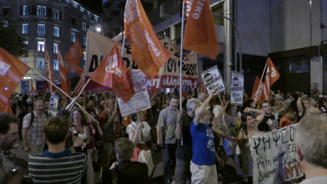 two shots sequence filmed moments after referendum results over bailout terms were announced view of greek parliament building in athens crowds of... - ユーロ圏債務危機点の映像素材/bロール