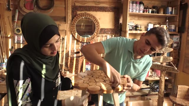 two siblings in the israeliblockaded gaza strip are making a living by producing decorative ornaments out of tree branches several months ago nidal... - footage technique stock videos and b-roll footage
