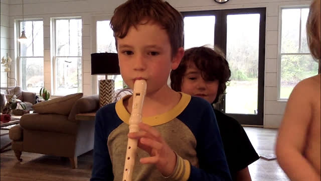 two siblings join in on their brothers virtual class session - playing stock videos & royalty-free footage