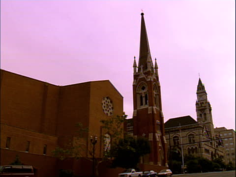 two side by side churches along a street - steeple stock videos & royalty-free footage