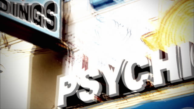 two signs advertise for a psychic and tarot readings. - fortune telling stock videos & royalty-free footage
