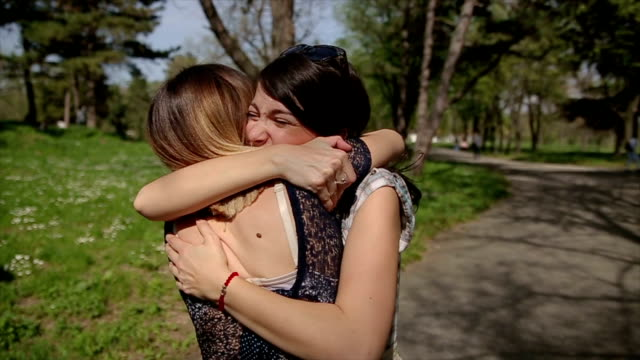 two sisters embrace enjoying meeting. - sibling stock videos and b-roll footage
