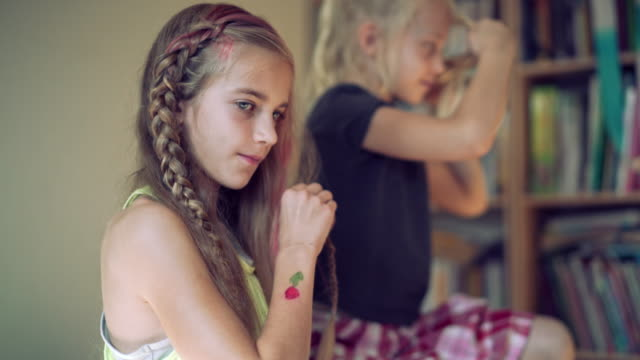 two sisters in kids room, oldest sister make hair dress. - 14 15 years stock videos and b-roll footage