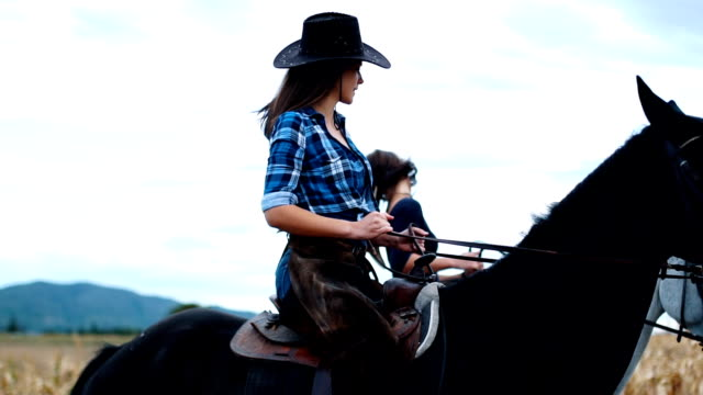 two sisters riding horses outdoors in slow mo - ranch stock videos & royalty-free footage