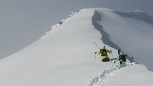 ws two skiers break trail in very deep snow, while hiking to peak / alta, snowbird, utah, usa - deep snow stock videos & royalty-free footage