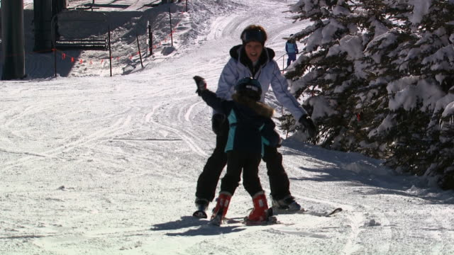 two skiers on a snow hill - ski jacket stock videos & royalty-free footage