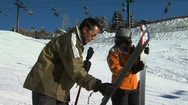 two skiers on a snow hill - ski jacket stock videos and b-roll footage
