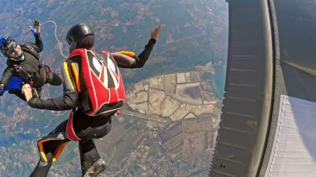 pov two skydivers jumping off plane - parachute stock videos & royalty-free footage