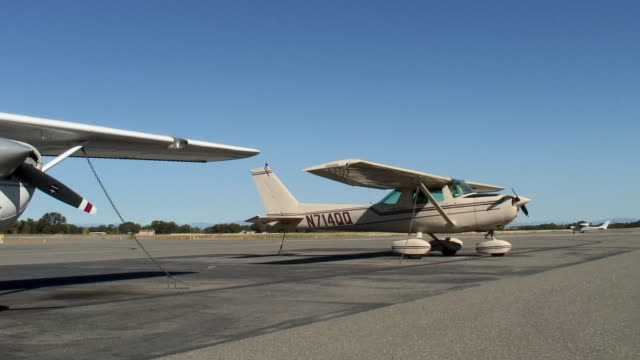 MS, PAN, Two small airplanes on tarmac, Red Bluff, California, USA