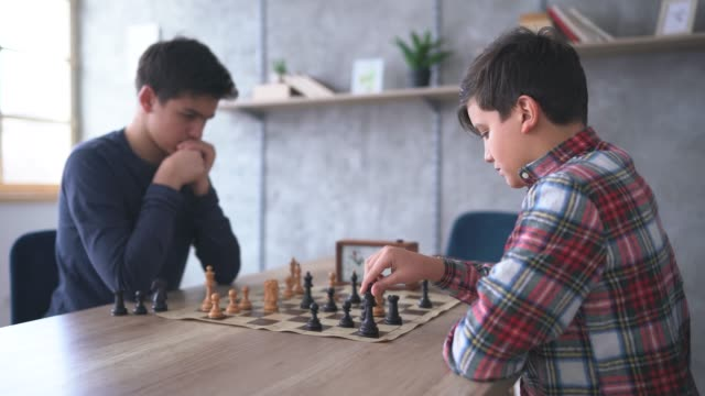 two smart boys playing a game of chess - chess stock videos & royalty-free footage