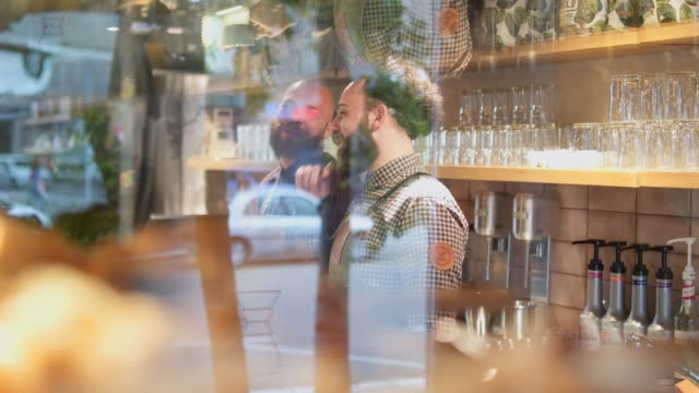 two smiling barista on a work - beard stock videos & royalty-free footage