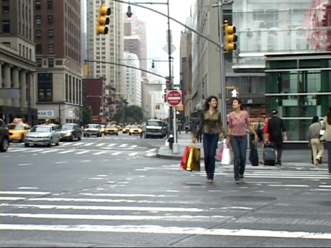 ws, two smiling women with shopping bags crossing street, columbus circle, new york city, new york, usa - columbus circle stock videos & royalty-free footage