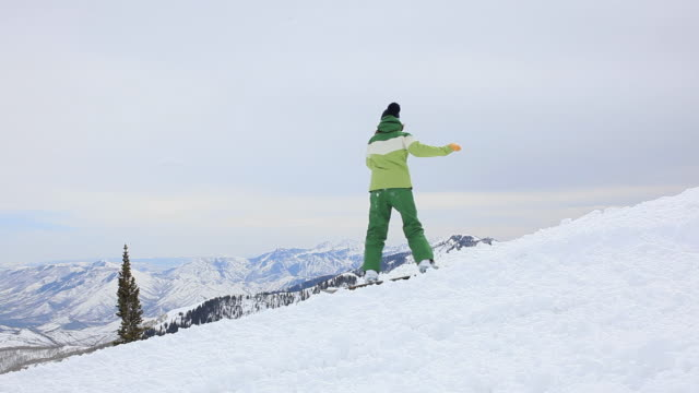 ws two snowboarders hiking up slope / brighton ski resort, utah, usa - ski jacket stock videos & royalty-free footage