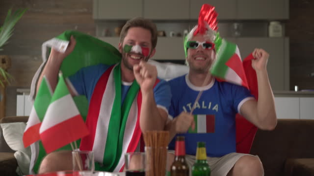 two soccer fans supporting Italy
