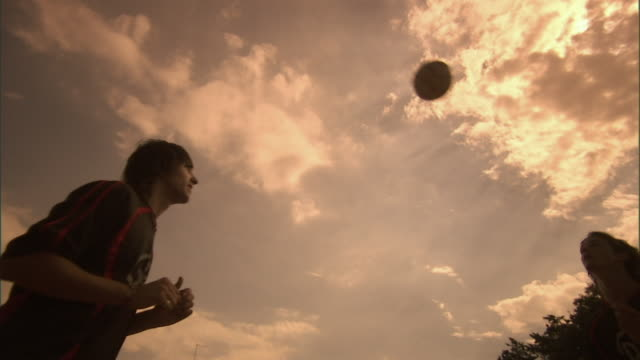 LA, MS, two soccer players bouncing ball on head, Buenos Aires, Argentina