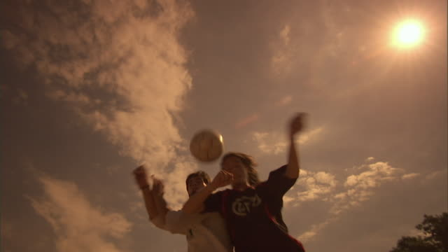 LA, MS, two soccer players competing for ball on field, Buenos Aires, Argentina
