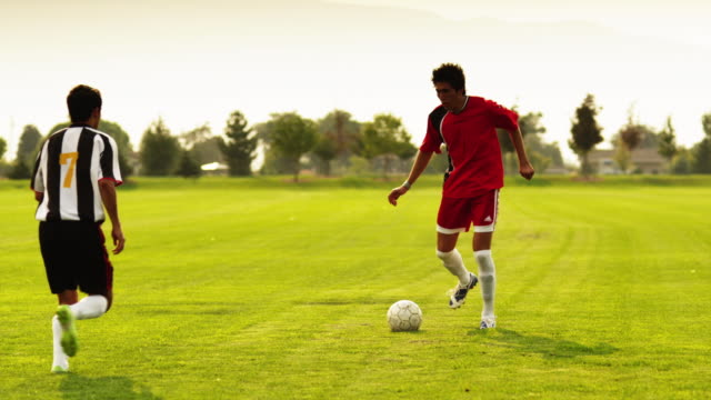 ms td two soccer players playing soccer on field / orem, utah, usa - orem utah stock videos & royalty-free footage