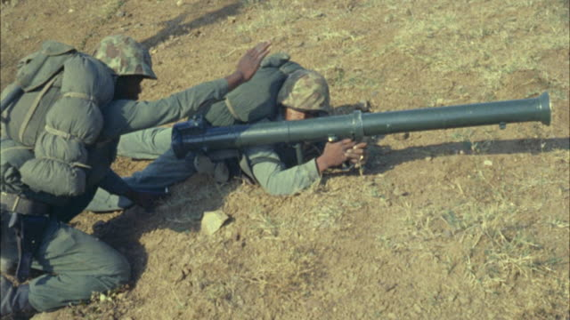 1967 montage ms two soldiers aiming with rocket launcher - rocket launcher stock videos & royalty-free footage