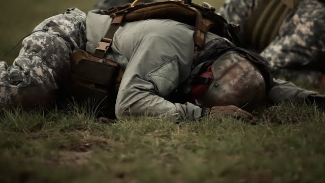 Two soldiers crawling across field