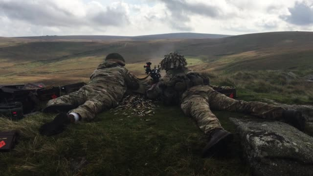 two soldier's from 6 rifles fire live ammunition from a general purpose machine gun on the range at okehampton camp dartmoor during the 6th battalion... - battalion stock videos & royalty-free footage