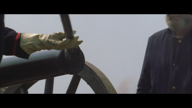 cu, reenactment two soldiers loading cannon - battlefield stock videos & royalty-free footage