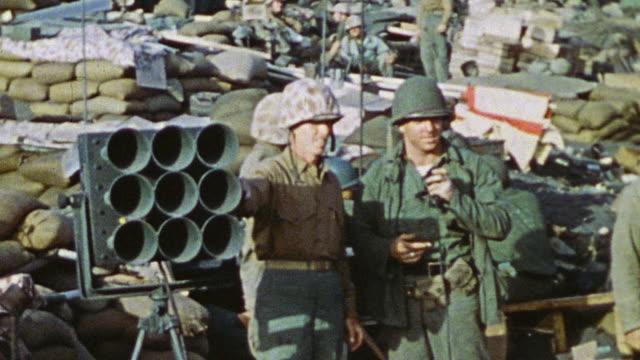 two soldiers stand next to a loudspeaker before officer makes announcements to soldiers at the command outpost / iwo jima japan - schlacht um iwojima stock-videos und b-roll-filmmaterial