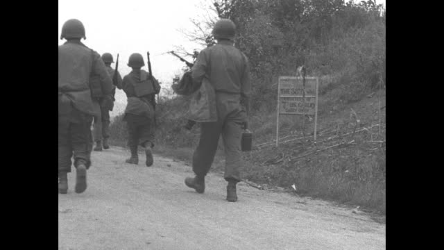 two soldiers stand on either side of sign that reads we are now crossing the 38th parallel courtesy of 7th us cavalry/ closer view of sign / view... - korean war stock videos & royalty-free footage