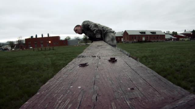 two soldiers surmounting a wall. - 軍隊点の映像素材/bロール