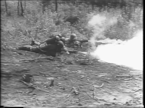 two soldiers with flame throwers creeping through underbrush / montage of soldiers using flamethrowers on a cylinder target targets going up in flames - cylinder stock videos & royalty-free footage