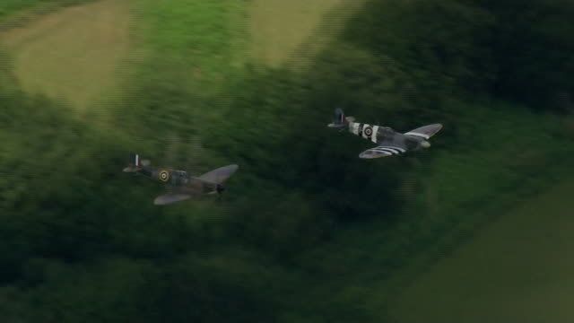 two spitfires flying over dame vera lynn's home village of ditchling on the day of her funeral - affectionate stock videos & royalty-free footage
