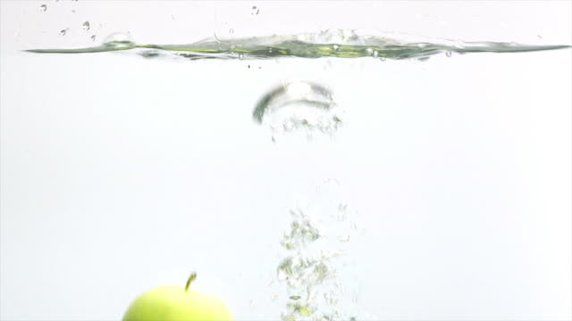 slo mo two splashing apples - textfreiraum stock videos & royalty-free footage