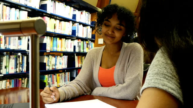 Two STEM high school female students work on assignment together