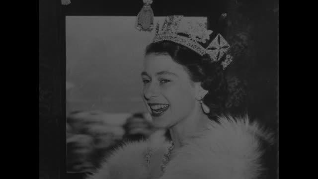 two stills one close one closer of same head shot of queen elizabeth smiling with crown pearl earrings and white fur she is on her way to preside at... - 1952 bildbanksvideor och videomaterial från bakom kulisserna