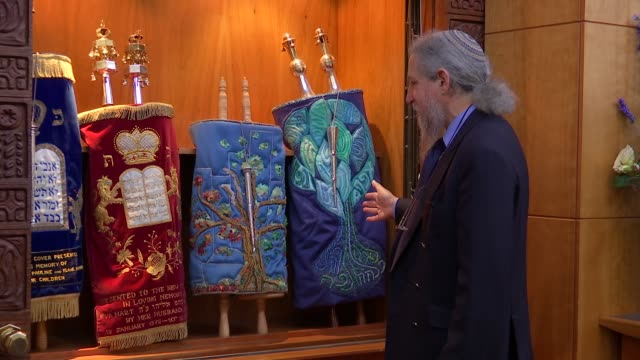 two stolen torah scrolls stolen from home of rabbis gvs scrolls england london int close shot as marker in the shape of a hand used to read hebrew... - torah stock videos and b-roll footage